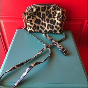 Leopard print bag that can be worn three ways.